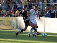 Adriane (left) attempts to steal the ball from Keri Sanchez (right). LA Sol and FC Gold Pride tied 0-0 at Buck Shaw Stadium in Santa Clara, California on July 23, 2009.