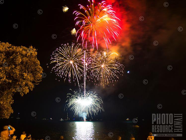 Spectators watch Fourth of July celebration fireworks from Kailua-Kona, Big Island.