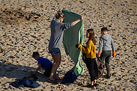 WEATHER PICTURE WALES<br /> A family on the beach during the unusually warm weather in Langland Bay near Swansea, Wales, UK. Wednesday 27 February 2019