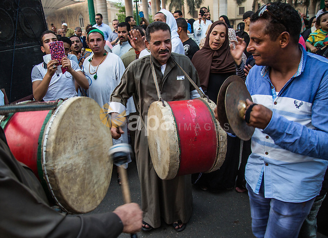 Egyptian Muslim Sufis play musical instruments as they parade through the streets during a ceremony to celebrate the Islamic new year, in Cairo on October 16, 2105. Photo by Amr Sayed
