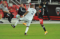 WASHINGTON, DC - SEPTEMBER 27: Andrew Farrell #2 of New England Revolution battles for the ball with Yordi Reyna #29 of D.C. United during a game between New England Revolution and D.C. United at Audi Field on September 27, 2020 in Washington, DC.