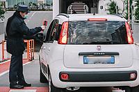 Torino 04-05-2020 <br /> The entrances to the FCA Fiat Chrysler Automobiles factory of the morning shift workers. <br /> In compliance with the safety regulations due to the Coronavirus Covid-19 pandemic, body temperature is measured using thermoscanners and pistol thermometerss besides the mandatory use of protective masks . <br /> Today, May 4, the second phase of the measures taken by the Italian government against the coronavirus pandemic began. <br /> <br /> Gli ingressi allo stabilimento di FCA Fiat Mirafiori degli operai del turno della mattina. In ottemperanza alle normative di sicurezza per la pandemia di Coronavirus Covid-19, viene misurata a tutti la temperatura corporea prima dell'ingresso in fabbrica, mediante termoscanner e termometri a pistola oltre all'uso obbligatorio delle mascherine protettive.<br /> Oggi è iniziata la fase due (2) delle misure contro la pandemia di coronavirus adottate dal governo italiano. <br /> Photo: Federico Tardito / Insidefoto