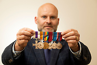 BNPS.co.uk (01202) 558833<br /> Pic: ZacharyCulpin/BNPS<br /> <br /> Pictured: Ned Cowell, medal specialist at Woolley & Wallis with the Eden medals<br /> <br /> The war medals of former British Prime Minister Anthony Eden have today sold for over £27,000 following a bidding war.<br /> <br /> Before entering politics, Eden served as a captain in the King's Royal Rifle Corps during World War One and was recognised for his gallantry.<br /> <br /> He fought with distinction on the Western Front at the Battle of the Somme and the Third Battle of Ypres despite the deaths of two of his brothers in the conflict.<br /> <br /> In the summer of 1916, Eden was awarded the Military Cross after helping to rescue a gravely wounded comrade under hostile fire during a trench raid near Ploegesteert.<br /> <br /> His medals were sold by a source close to the Eden family with auctioneers Woolley & Wallis, of Salisbury, Wilts. It is believed that this is the first time the medals of a 20th century British Prime Minister have been offered at auction.