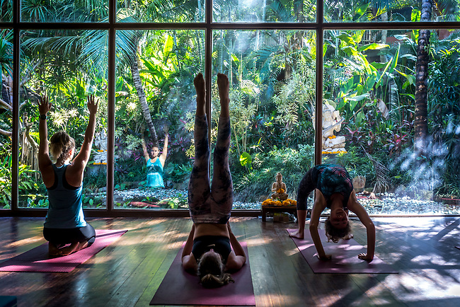 6 DECEMBER, 2019 BALI, INDONESIA:  From left to right Lea Lock (23), Chanel Gricius (23) and Zoe Giliomee (24)  loosen up for a class at The Yoga Barn in Ubud, Bali. There has been a levelling out of Australian tourist numbers to Bali in recent times and tastes are changing regarding what people want from their holiday. Millennials are being targeted by tourism authorities and they want to give them more boutique experiences than just beach and beer. Picture by Graham Crouch/The Australian