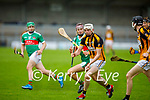 Abbeydorney's full back Stephen Egan in possession as he  tries to clear his defence under pressure as Crotta's Donal Hunt gives chase in the round 2 game of the County Senior hurling championship