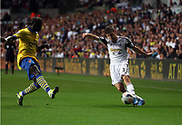 Saturday 28 September 2013<br /> Pictured: Ben Davies of Swansea (R) and Bacary Sagna of Arsenal (L)<br /> Re: Barclay's Premier League, Swansea City FC v Arsenal at the Liberty Stadium, south Wales.