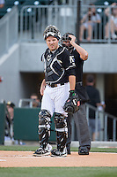 Charlotte Knights catcher Jeremy Dowdy (14) on defense against the Columbus Clippers at BB&T BallPark on May 27, 2015 in Charlotte, North Carolina.  The Clippers defeated the Knights 9-3.  (Brian Westerholt/Four Seam Images)