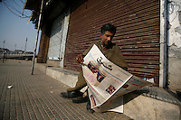 A man reads a newspaper with the result of the US election on its front page, as all shops are closed due to a curfew. Paramilitary police enforced a curfew imposed to stop separists gather for a political demonstration in Srinagar, Kashmir, India. © Fredrik Naumann/Felix Features