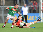 Stephen Moloney of Kilmurry Ibrickane in action against Cormac Ryan of Clondegad during their senior county final at Cusack park. Photograph by John Kelly.
