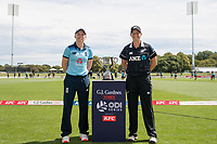 23rd February 2021, Christchurch, New Zealand;  Heather Knight (c) of England and Sophie Devine of New Zealand, during the 1st ODI Cricket match, New Zealand versus England, Hagley Oval, Christchurch, New Zealand