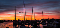 Two images have been merged to create a mini-pano of the harbor at San Leandro Marina on San Francisco Bay at sunset.
