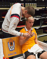 The Netherlands, Den Bosch, 16.04.2014. Fed Cup Netherlands-Japan, Practice, Richel Hogenkamp (NED) gets a treatment from fysio Edwin Visser(NED)<br /> Photo:Tennisimages/Henk Koster