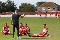 Ramsgate Manager, Matt Longhurst, discusses tactics with some of his players at half-time during Ramsgate vs Folkestone Invicta, Friendly Match Football at Southwood Stadium on 1st August 2020