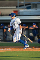 Colton Frabasilio (18) of the Burlington Royals follows through on his swing against the Bluefield Blue Jays at Burlington Athletic Park on June 29, 2015 in Burlington, North Carolina.  The Royals defeated the Blue Jays 4-1. (Brian Westerholt/Four Seam Images)