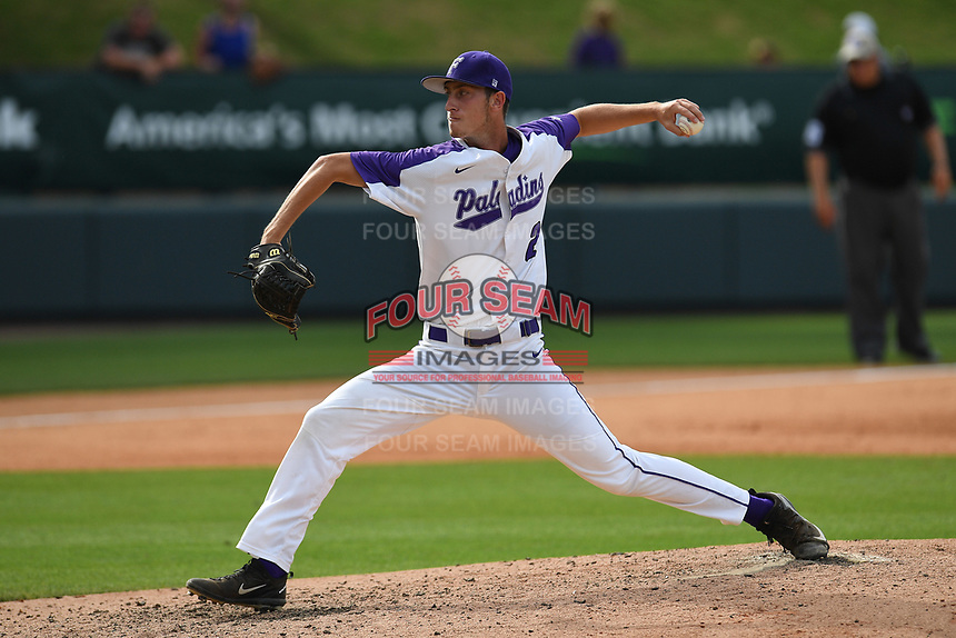 Pitcher Billy Greenfield (23) of the Furman Paladins delivers a pitch in a game against the UNC Greensboro Spartans in the title game of the Southern Conference Championship series on Sunday, May 28, 2017, at Fluor Field at the West End in Greenville, South Carolina. UNCG won, 13-1. (Tom Priddy/Four Seam Images)