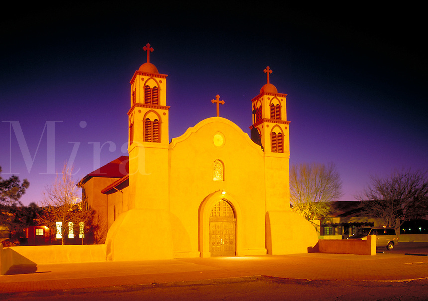 Nighttime view of Roman Catholic church built in 1819-21 and still in use. A portion of the south wall dates from the original 1598 mission which was destroyed in Pueblo Rebellion of 1680. Socorro New Mexico USA Socorro, NM.