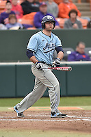 Main Black Bears first baseman Brenden Geary (22) swings at a pitch during a game against the Clemson Tigers at Doug Kingsmore Stadium on February 20, 2016 in Clemson, South Carolina. The Tigers defeated the Black Bears 9-4. (Tony Farlow/Four Seam Images)