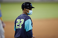 Lynchburg Hillcats manager Dennis Malave (22) coaches third base during the game against the Myrtle Beach Pelicans at Bank of the James Stadium on May 22, 2021 in Lynchburg, Virginia. (Brian Westerholt/Four Seam Images)