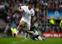 Photo: Richard Lane/Richard Lane Photography. England v Ireland. 17/03/2012. England's Manu Tuilagi breaks from Ireland's Keith Earls.