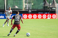 LAKE BUENA VISTA, FL - JULY 13: Felipe Martins #18 of DC United dribbles the ball during a game between D.C. United and Toronto FC at Wide World of Sports on July 13, 2020 in Lake Buena Vista, Florida.
