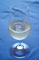Glass of white wine with the text Chateau Vannieres against a blue table cloth Chateau Vannieres (Vannières) La Cadiere (Cadière) d'Azur Bandol Var Cote d'Azur France