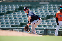 Atlanta Braves first baseman Austin Bush (59) picks a throw in the dirt during an Instructional League game against the Baltimore Orioles on September 25, 2017 at Ed Smith Stadium in Sarasota, Florida.  (Mike Janes/Four Seam Images)