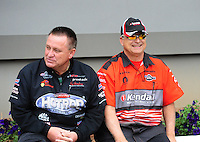 Sept. 18, 2011; Concord, NC, USA: NHRA pro stock driver V. Gaines (right) with Ronnie Humphrey during the O'Reilly Auto Parts Nationals at zMax Dragway. Mandatory Credit: Mark J. Rebilas-