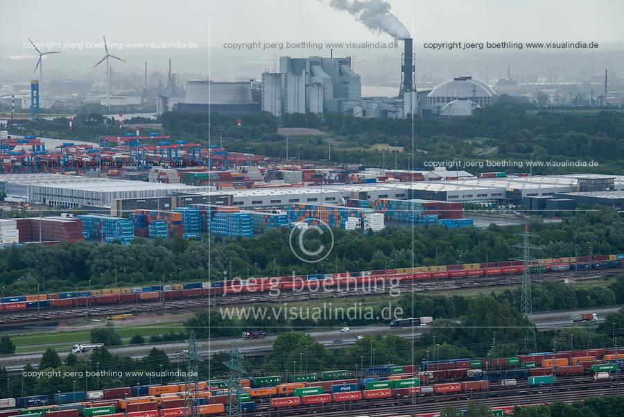 GERMANY, Hamburg, view from wind turbine to Vattenfall coal power station in harbour / DEUTSCHLAND, Hamburg, Blick vom Trimet Gelaende, von einer Windkraftanlage auf Bahngelaende mit Container Waggons im Hafen und Kohlekraftwerk Moorburg von Vattenfall