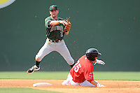 Tim Roberson of the Greenville Drive is out at second as second baseman Ryan Jones (2) of the Augusta GreenJackets turns a double play in a game on Sunday, July 13, 2014, at Fluor Field at the West End in Greenville, South Carolina. Greenville won, 8-5. (Tom Priddy/Four Seam Images)
