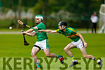 Ballyduffs David Goulding clears his defence despite the pressure from Lixnaws Mikey Kelliher in the NK Hurling Championship game on Monday.
