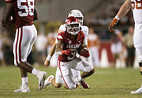 Arkansas defensive back Greg Brooks Jr. (9) runs a ball recovered from a Texas fumble, Saturday, September 11, 2021 during the third quarter of a football game at Reynolds Razorback Stadium in Fayetteville. Check out nwaonline.com/210912Daily/ for today's photo gallery. <br /> (NWA Democrat-Gazette/Charlie Kaijo)