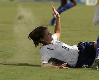 Mia Hamm slide tackle...Photo by: J. Brett Whitesell/ISI