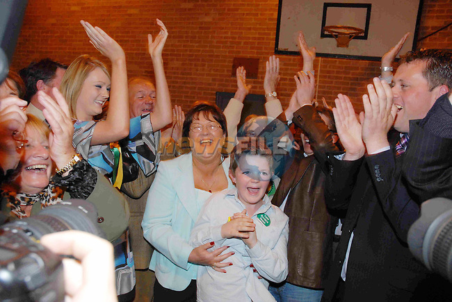 Mary Wallace (FF) celebrates retaining her seat in Meath East with husband declan and son Tom..Photo NEWSFILE/Andy Spearman.(Photo credit should read FRAN CAFFREY/NEWSFILE)...This Picture has been sent you under the condtions enclosed by:.Newsfile Ltd..the Studio,.Millmount Abbey,.Drogheda,.Co Meath..Ireland..Tel: +353(0)41-9871240.Fax: +353(0)41-9871260.GSM: +353(0)86-2500958.email: pictures@newsfile.ie.www.newsfile.ie.FTP: 193.120.102.198..This picture is from Fran Caffrey@newsfile.ie