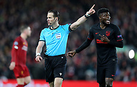 Referee Danny Makkelie gestures as Atletico Madrid's Thomas Partey reacts <br /> <br /> Photographer Rich Linley/CameraSport<br /> <br /> UEFA Champions League Round of 16 Second Leg - Liverpool v Atletico Madrid - Wednesday 11th March 2020 - Anfield - Liverpool<br />  <br /> World Copyright © 2020 CameraSport. All rights reserved. 43 Linden Ave. Countesthorpe. Leicester. England. LE8 5PG - Tel: +44 (0) 116 277 4147 - admin@camerasport.com - www.camerasport.com