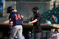Home plate umpire Darius Ghani instructs Colton Welker (24) to return to the batter's box during a California League game between the Lancaster JetHawks and Inland Empire 66ers at San Manuel Stadium on May 20, 2018 in San Bernardino, California. Inland Empire defeated Lancaster 12-2. (Zachary Lucy/Four Seam Images)