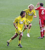Columbus Crew forwards Guillermo Barros Schelotto (7) and Steven Lenhart (32) celebrate Schelotto's game-tying goal on a penalty kick.  The Columbus Crew tied the Chicago Fire 2-2 at Toyota Park in Bridgeview, IL on September 20, 2009.