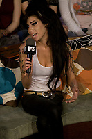"""Toronto (ON) CANADA, May 11, 2006<br /> <br /> Critically-acclaimed British singer/songwriter Amy Winehouse  join """"MTV Live"""" hosts Daryn Jones and Aliya-Jasmine Sovani for her first in-studio interview at the Masonic Temple on Friday, May 11 at 1:20 p.m.  Winehouse discuss the release of her latest album Back to Black before an intimate audience of fans. <br /> <br /> photo by Cody Bokchowan - Images Distribution"""