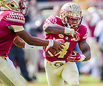 Florida State quarterback Everett Golson fakes a hand off to running back Dalvin Cook during the first half of Florida State's 34-17 win over N.C. State during their homecoming NCAA football game in Tallahassee, FL November 14, 2015.