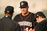 Delmarva Shorebirds manager Ryan Minor #44 talks with the umpires prior to the start of the game against the Kannapolis Intimidators at Fieldcrest Cannon Stadium May 12, 2010, in Kannapolis, North Carolina.  Photo by Brian Westerholt / Four Seam Images