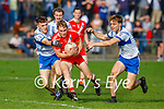 Ciam Ó Murchú of An Gealtacht in possession as he his tackled by Castleialnd Desmonds Luka Brosnan and Dominick Finnegan in the Intermediate Club football Championship Quarter-Final