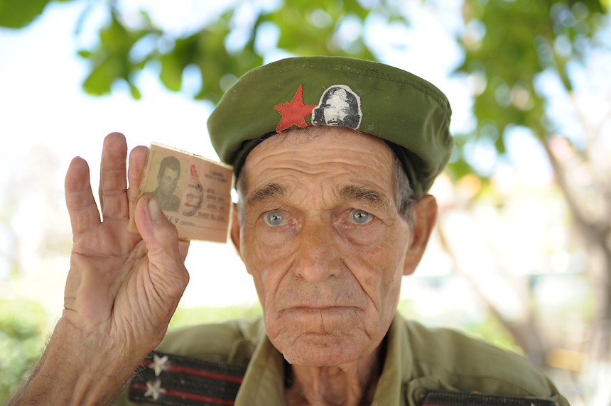 A man who says he took part in the revolution pledges his allegiance to the Cuban Communist Party in Varadero, Cuba. MARK TAYLOR GALLERY