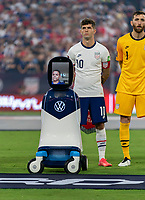NASHVILLE, TN - SEPTEMBER 5: Christian Pulisic #10 of the United States stands with CHAMP during a game between Canada and USMNT at Nissan Stadium on September 5, 2021 in Nashville, Tennessee.