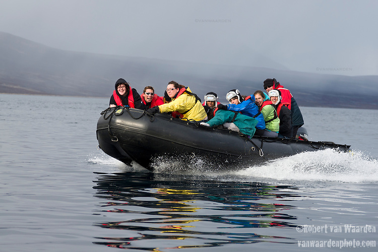 Laughing students from the Cape Farewell Youth Expedition ride a zodiac back to the ship. The students are part of the Cape Farewell Youth Expedition that was organized by the British Council of Canada.