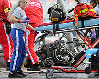 DAYTONA BEACH, FL - FEBRUARY 23: Medical personnel assist fans injured following an accident at the finish of the NASCAR Nationwide Series DRIVE4COPD 300 that sent 28 people to the hospital. Involved in the crash are Kyle Larson, driver of the #32 Clorox Chevrolet, Justin Allgaier, driver of the #31 Brandt Chevrolet, Brian Scott, driver of the #2 Shore Lodge Chevrolet, and Parker Kligerman, driver of the #77 Bandit Chippers Toyota, are involved in an incident at the finish of the NASCAR at Daytona International Speedway. on February 23, 2013 in Daytona Beach, Florida.<br /> <br /> <br /> People:  Medical Personnel Assist Fans