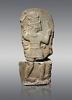 Hittite monumental relief sculpture of a god probably about to kill a lion (missing) with his axe. Late Hittite Period - 900-700 BC. Adana Archaeology Museum, Turkey. Against a grey background