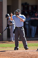 Home plate umpire Clint Lawson makes a strike call during the NCAA baseball game between the Kennesaw State Owls and the Winthrop Eagles at the Winthrop Ballpark on March 15, 2015 in Rock Hill, South Carolina.  The Eagles defeated the Owls 11-4.  (Brian Westerholt/Four Seam Images)