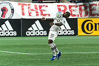 FOXBOROUGH, MA - SEPTEMBER 23: Zachary Brault-Guillard #15 of Montreal Impact chest trap during a game between Montreal Impact and New England Revolution at Gillette Stadium on September 23, 2020 in Foxborough, Massachusetts.