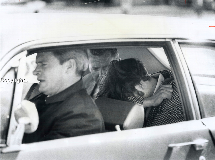1970 FILE PHOTO - ARCHIVES -<br /> <br /> Charged with Non-Capital murder in the slaying of 23-year-old Ghislaine Fortin; Philip Dumas; 17; hides his face as he sits with detectives in a police car. The nude body of Miss Fortin; a teacher; was found in a Sheppard Ave. boarding house where Dumas lived with his father. She had been raped; stabbed and strangled. She had come to Metro Toronto  from Quebec last September.<br /> <br /> 1970<br /> <br /> PHOTO : Boris Spremo - Toronto Star Archives - AQP