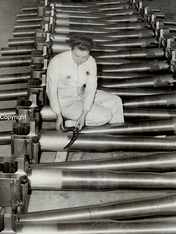 Down in Quebec women are playing a big role in a gun plant and here Isobel MacKenzie inspects six-pounder gun parts.<br /> <br /> PHOTO :    - Toronto Star Archives - AQP