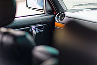 The passenger door lever Mercedes W123 series 230TE estate version, outside the Penderyn Whisky Distillery in south Wales, UK. Tuesday 19 June 2018
